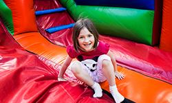 Little girl playing in a bounce house