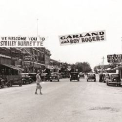 Photo of Main Street looking east. Banners welcoming Roy Rogers and Smiley Burnett can be seen. Click to go to an information page concerning Garland's history.